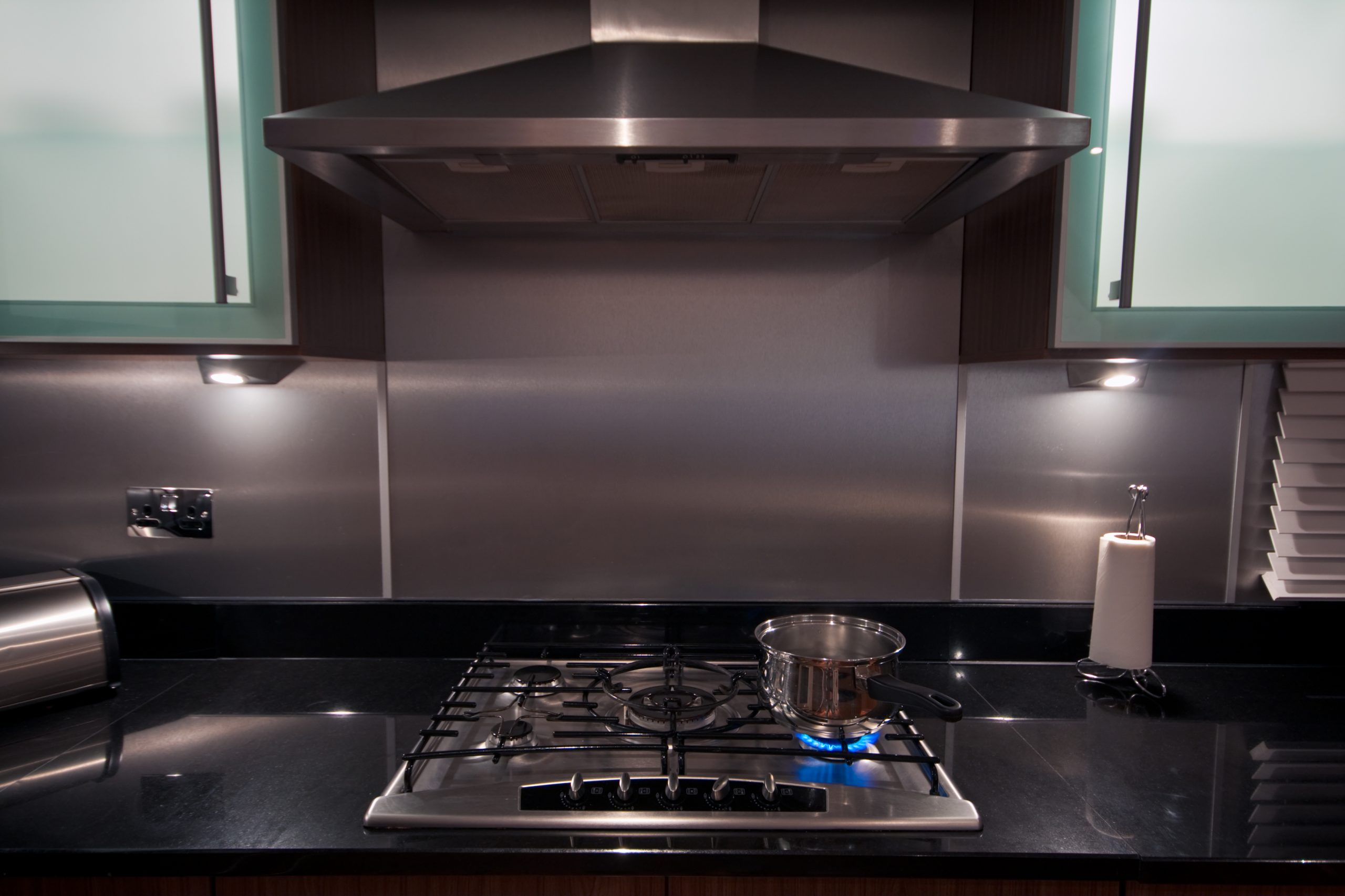 Stainless steel pan on gas hob in a modern kitchen